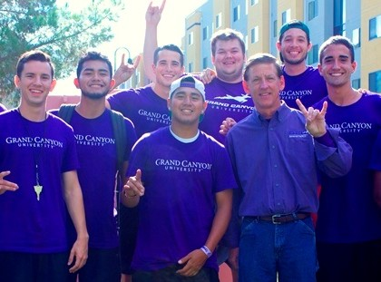 GCU Move-In volunteers on Friday were pumped up by a photo-bomb episode with President and CEO Brian Mueller.