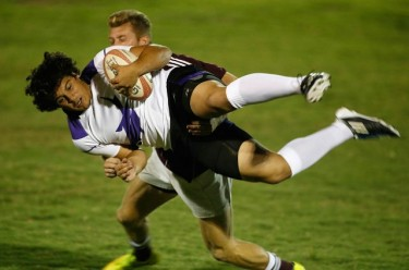 Things can go a little sideways when a player gets tackled. Photo by Darryl Webb