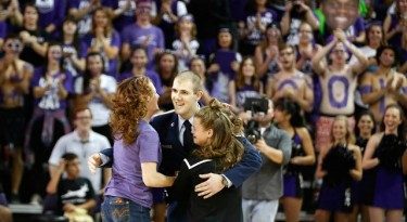 Javen Manning (center) surprised his sisters, Jessalyn (left) and GCU sophomore Lauryn during Saturday night's men's basketball game with help from a few sworn-to-secrecy folks at the University. (Photo by Darryl Webb)