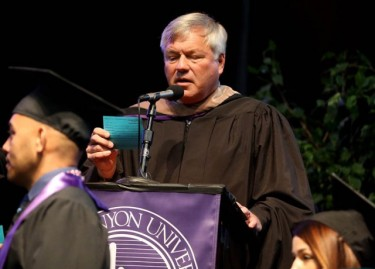 Dave Smith overcame laryngitis to again be a name reader at commencement. (Photo by Darryl Webb)