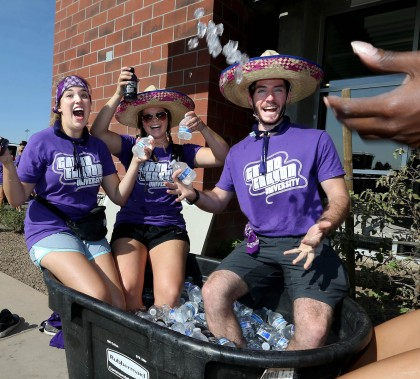 Student volunteers found a good use for the bins full of ice and cold drinks. (Photo by Darryl Webb)