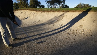 Hit your ball into one of the many bunkers at the redesigned course and you probably will have to hit it over a big wall of sand. (Photo by Darryl Webb)