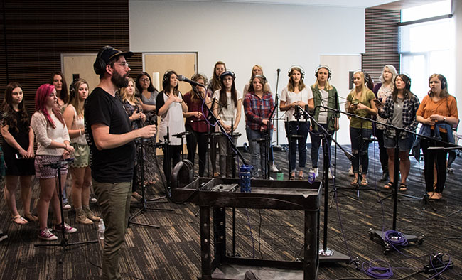 Gareth Gilkeson leads students from GCU's Center for Worship Arts in one of the eight songs that were recorded Monday in the University's new studio.