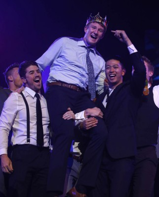 Joshua Braun is hoisted up after being named Mr. GCU.